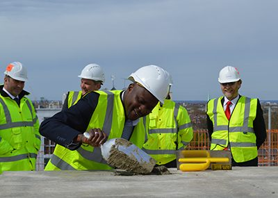 Staff at a topping out ceremony at Grand Regent Tower, London