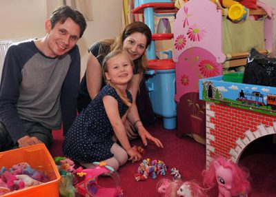 Family moving into a home in Bradninch