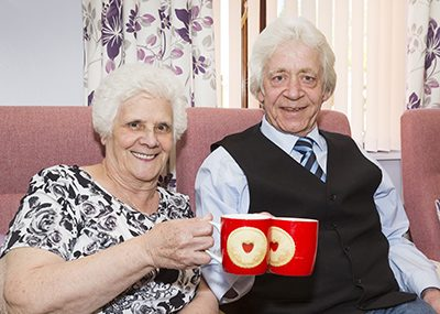 Older couple drinking tea