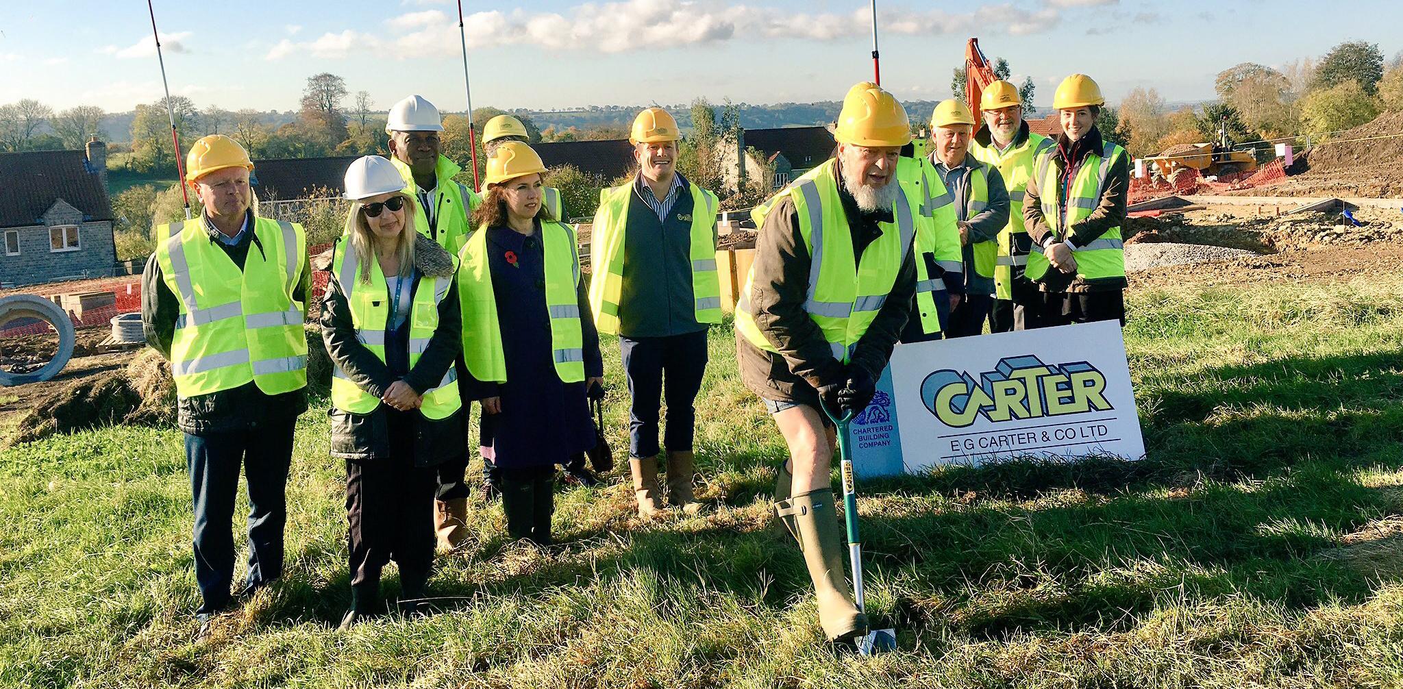 Michael Eavis, Glastonbury Festival's founder, digging at new building site.