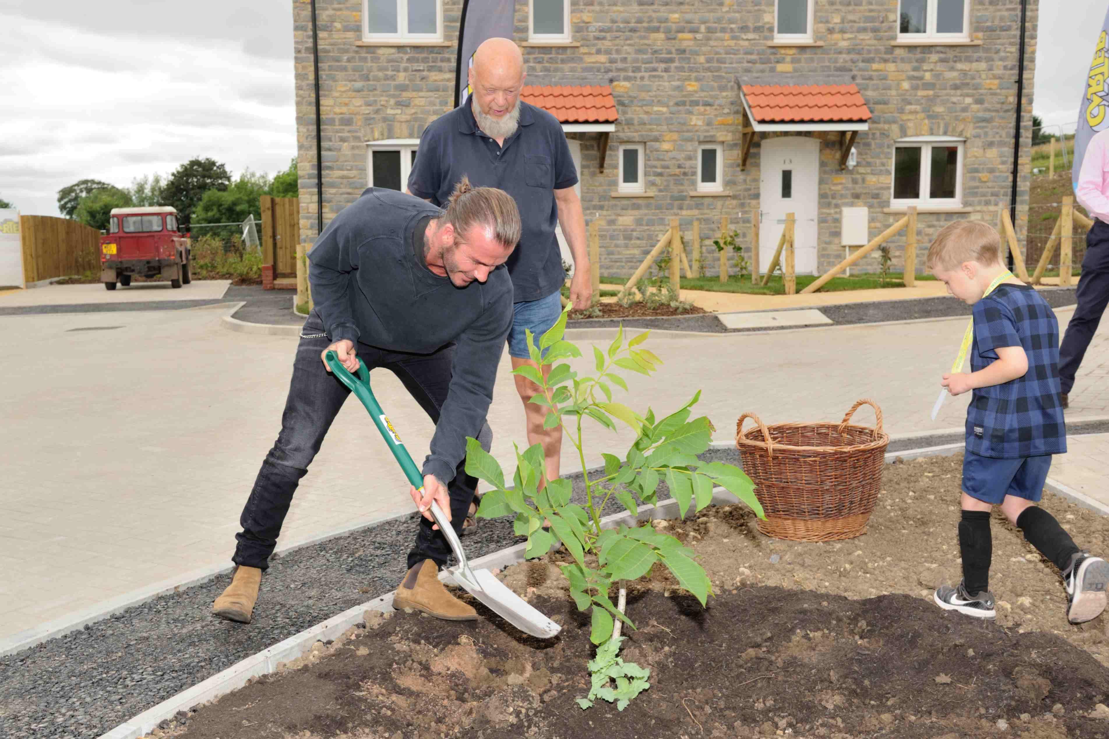 David Beckham planting a tree at Pilton, Somerset